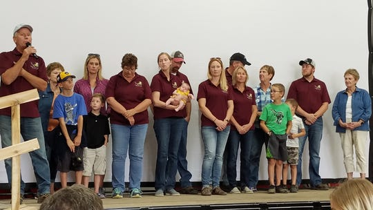 Peirick family members gathered on stage to welcome about 200 visitors to their farm to celebrate Conservation Observance Day last week.