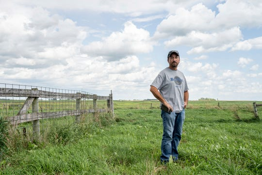 Farmer Troy Windschitl stands for a portrait on his farm outside of Sleepy Eye, Minn. Windschitl is a third generation farmer who has grown peas and sweet corn for Del Monte for over 20 years.