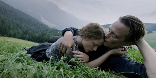 "Valerie Pachner and August Diehl star as an Austrian farming couple separated from each other by the Nazis in the World War II drama ""A Hidden Life."""
