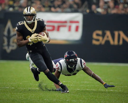 New Orleans Saints wide receiver Michael Thomas runs past Houston Texans cornerback Lonnie Johnson during the first quarter at the Mercedes-Benz Superdome in New Orleans.