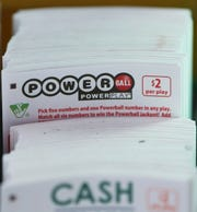 Powerball play slips are stacked up in a store Jan. 5, 2016, in Richmond, Va.