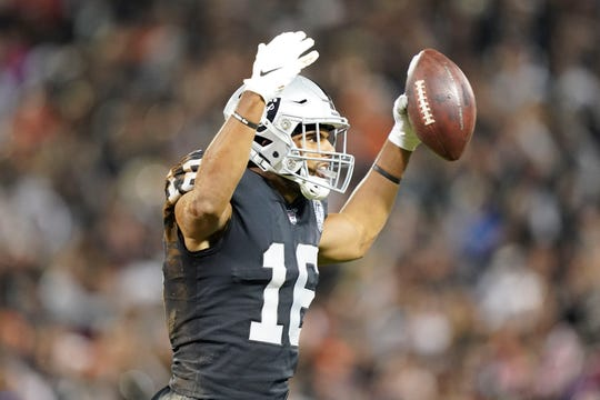 Oakland Raiders wide receiver Tyrell Williams celebrates after making a catch against the Denver Broncos during the second quarter.