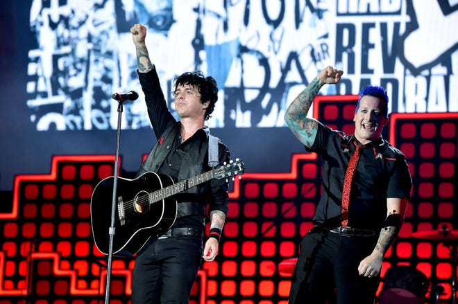 "Musicians Billie Joe Armstrong and Tre Cool of Green Day perform during the 2017 Global Citizen Festival in New York City. Green Day announced it will tour with Weezer and Fall Out Boy for the ""Hella Mega"" stadium tour."