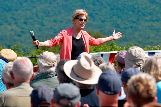 Democratic presidential candidate Elizabeth Warren speaks to supporters during a campaign stop and town hall at Toad Hill Farm in Franconia, New Hampshire, overlooking the White Mountains on August 14, 2019.