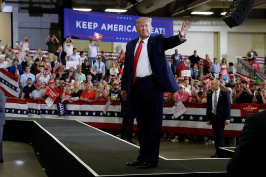 President Donald Trump waves to the crowd after a campaign rally at the Crown Expo, Monday, Sept. 9, 2019, in Fayetteville, N.C. (AP Photo/Evan Vucci) ORG XMIT: NCEV355