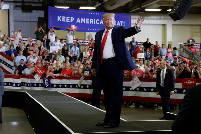 President Donald Trump waves to the crowd after a campaign rally at the Crown Expo on Sept. 9 in Fayetteville.