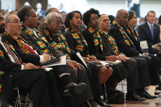 """Members of the Congressional Black Caucus listen during an event at the  U.S. Capitol Sept. 10 to commemorate """"the 400th anniversary of the first-recorded forced arrival of enslaved African people."""""""