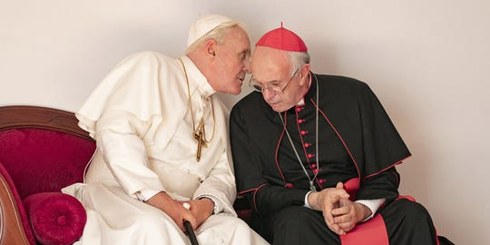 "Anthony Hopkins (left) stars as Pope Benedict and Jonathan Pryce is Cardinal Jorge Mario Bergoglio (the future Pope Francis) in ""The Two Popes."""