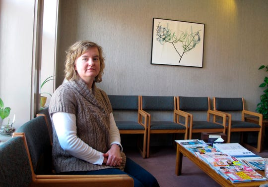 In this Feb. 20, 2013, file photo, Tammi Kromenaker, director of the Red River Valley Women's Clinic, North Dakota's sole abortion provider, sits in the waiting area of the facility in Fargo, N.D.