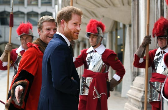Elaborately costumed guards greet Prince Harry as he arrives at the Guildhall in London to mark the fifth anniversary of the Invictus Games.