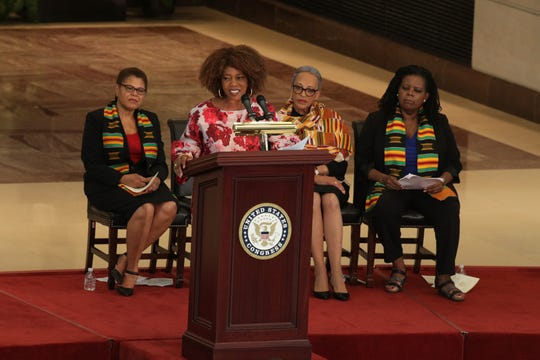 Actress Alfre Woodard speaks as Rep. Karen Bass, D-Calif., chairwoman of the Congressional Black Caucus, anthropologist Johnnetta Cole and historian Annette Gordon-Reed listen during a commemoration event at the Emancipation Hall of the U.S. Capitol September 10, 2019 in Washington, DC.