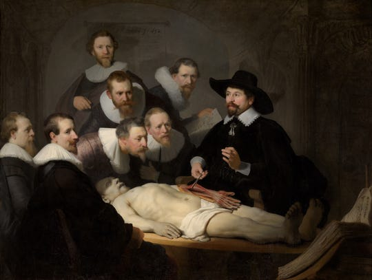 """The Anatomy Lesson of Dr Nicolaes Tulp"" was painted by Rembrandt in 1632. ""The Goldfinch"" shows the painting damaged in a bombing incident. That's fiction: It remains housed, undamaged, in the Mauritshuis museum in The Hague, Netherlands."