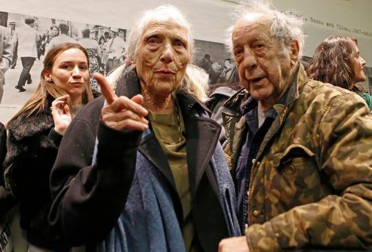 "Photographer and filmmaker Robert Frank, right, and his wife June Leaf, center, attend the opening of the exhibition featuring his work, ""Robert Frank: Books and Films, 1947–2016,"" at New York University's Tisch School of the Arts, Jan. 28, 2016, in New York."