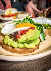 Denver's Snooze pumps their avocado toast up with red-onion honey jam.