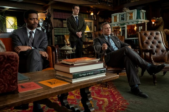 "Lt. Elliott (LaKeith Stanfield, from left), Trooper Wagner (Noah Segan) and Benoit Blanc (Daniel Craig) in the murder mystery ""Knives Out."""