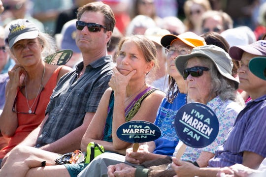 Supporters of Democratic candidate for United States President Senator Elizabeth Warren listen to her during a town hall style meeting at Toads Hill Farm in Franconia, New Hampshire, USA 14 August 2019.