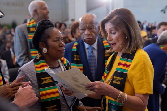 Democratic Speaker of the House Nancy Pelosi (right) speaks with Democratic Reps. John Lewis of Georgia and Sheila Jackson Lee of Texas during a Sept. 10 commemoration of the the 400th anniversary of the arrival of a ship with enslaved African People to the English colonies.