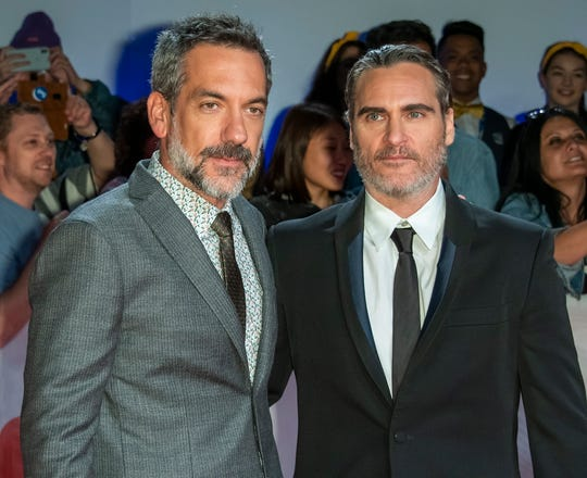 "Director Todd Phillips (left) and Joaquin Phoenix arrive at the ""'Joker"" premiere during the 2019 Toronto International Film Festival."
