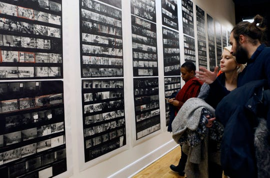 "Spectators look at a wall of enlarged contact sheets of photographs for the book ""The Americans, "" by Robert Frank at the opening of an exhibition featuring his work, ""Robert Frank: Books and Films, 1947–2016,"" at New York University's Tisch School of the Arts, Jan. 28, 2016, in New York."