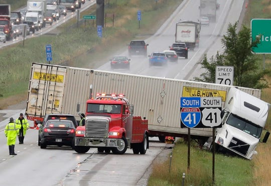 Police respond to a Sept. 11 crash on southbound Interstate 41 between Ballard Road and Richmond Street in Appleton. That section of highway will be widened from two lanes to three lanes.