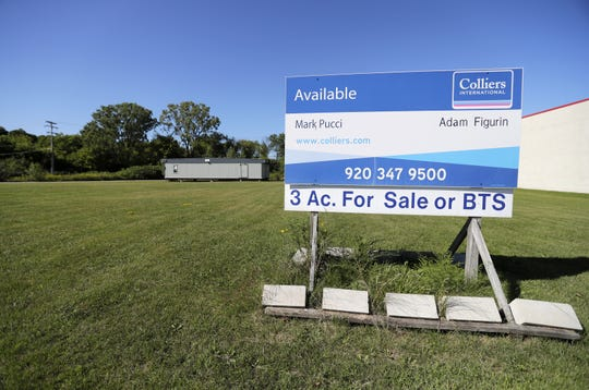 The lot for sale next to the Gordon Food Service Store in Grand Chute.