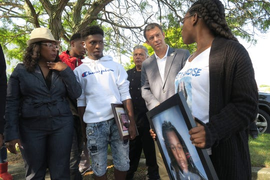 Monmouth County Prosecutor Christopher Gramiccioni speaks with Jehadje J. McMillian's family members (l-r): mother Nikkia Jennings-Fitzpatrick; brother Nyree Jennings, 16; and sister Aniyah Mcleod, 17; outside St. Stephen's Church on Springwood Avenue in Asbury Park Wednesday, September 11, 2019.  The prosecutor announced that four men were arrested on charges related to McMillian's death.