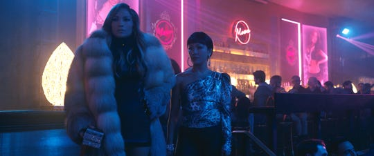 "Jennifer Lopez, left, and Constance Wu star in ""Hustlers."""