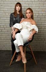 "Lorene Scafaria, left, writer/director of the film ""Hustlers,"" poses with cast member Jennifer Lopez during the Toronto International Film Festival on Sept. 8 in Toronto."