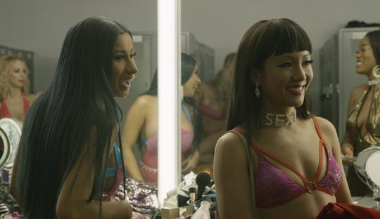 """Cardi B, left, and Constance Wu star in """"Hustlers."""""""