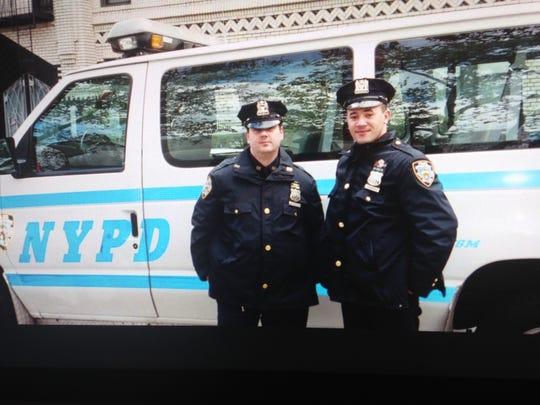Christopher Raiola (left) working for the New York City Police Department in an undated photo.