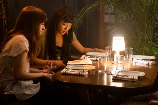 """Director Lorene Scafaria, left, and Constance Wu behind the scenes on the set of """"Hustlers."""""""