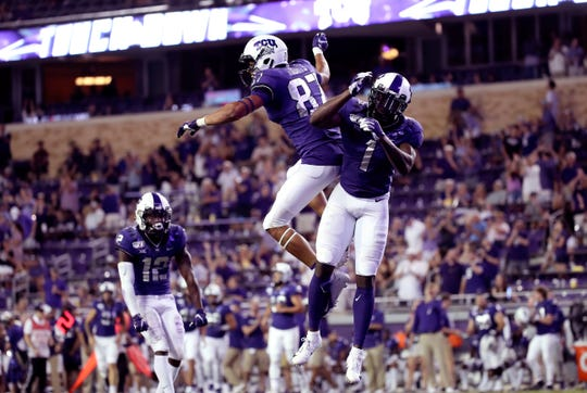 Aug 31, 2019; Fort Worth, TX, USA;  TCU Horned Frogs wide receiver Jalen Reagor (1) celebrates with wide receiver TreVontae Hights (87) after scoring a touchdown during the second half against the Arkansas-Pine Bluff Golden Lions at Amon G. Carter Stadium. Mandatory Credit: Kevin Jairaj-USA TODAY Sports