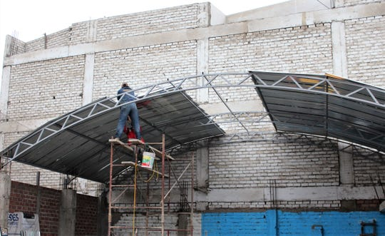 Almost done - the individual cost of those on a short-term mission trip to Lima, Peru, included funds to build a metal roof over an area that will be used to serve food to neighborhood residents at the Comas 13 church.  Aug. 9 2019