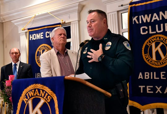 Tye Police Chief Jay Strong addresses the Abilene Kiwanis Club after receiving the Melvin Martin First Responder of the Year Award during the group's monthly luncheon Wednesday at the Abilene Country Club.