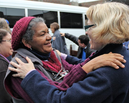 Susana Grados , left, and Jocelyn Furr embrace during a farewell song at the Comas 13 Methodist church. Aug. 9 2019
