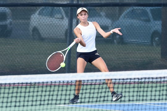 Abilene High's Cassie Hernandez hits a shot during the mixed doubles match at Cooper on Tuesday, Sept. 10, 2019. Hernandez and partner Bennett Sullivan won 6-1, 6-1. She also won 6-3, 6-2 at No. 5 girls singles as AHS won 19-0.