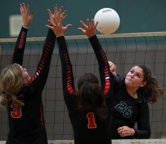 Crosspoint's Holli Hunter (3) and Ashlyn Hanson (1) try to block a shot by Klahowya's Chloe Settle (26) during their game on Tuesday September 10, 2019.
