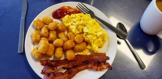 Vera LaRoe‎ discovered the joy of tater tots for breakfast at Dottie's Restaurant in Palm Bay.