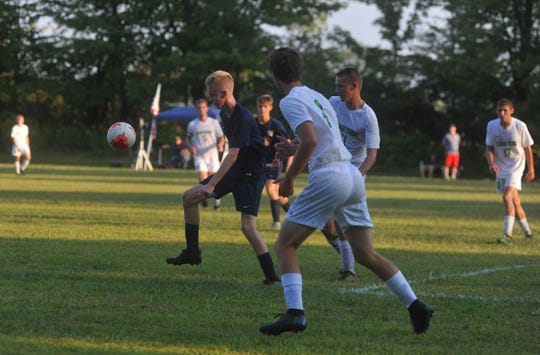 Galion's Jack Hart gains possession of the ball with Clear Fork's Grayson George and Isaac Kistler closing in.