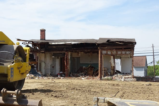 A concrete building at 1517 E. Mansfield St. is being demolished to make way for a new Burger King.