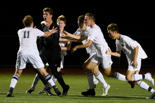 Essex celebrates a goal by goalie Andrew Seavers (99) during the high school boys soccer game between the Essex Hornets and the Burlington Seahorses at Buck Hard Field on Tuesday night September 10, 2019 in Burlington, Vermont.