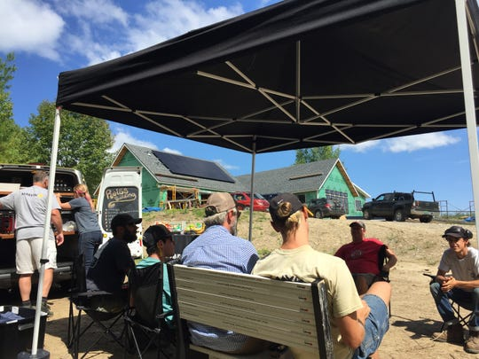 Workers from Reiss Building and Renovation relax at lunch provided by the Break Time By Brownell food truck on a job site in Monkton on Sept. 6, 2019.