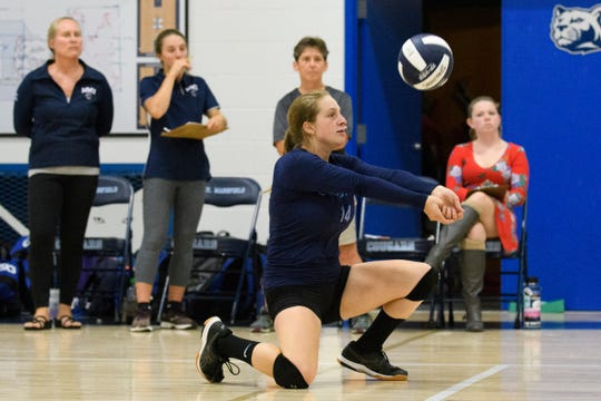 MMU's Natalie Malmgren (14) plays the ball during the high school girls volleyball match between Lyndon Institute and Mount Mansfield on Wednesday afternoon September 11, 2019 in Jericho, Vermont.