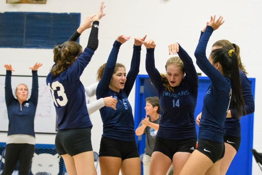 MMU celebrates a point during the high school girls volleyball match between Lyndon Institute and Mount Mansfield on Wednesday afternoon September 11, 2019 in Jericho, Vermont.