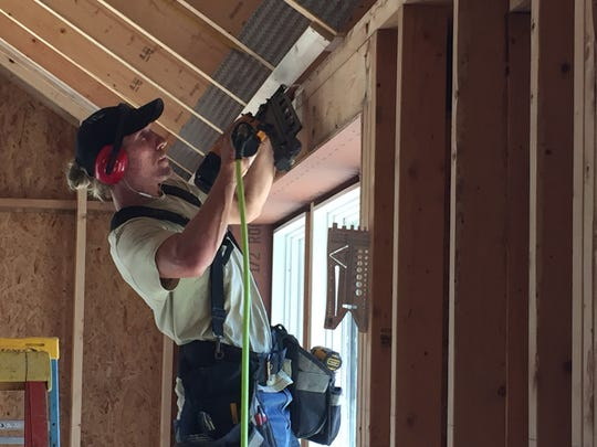 Will Hemingway, an employee of Reiss Building and Renovation, works on a home under construction in Monkton on Sept. 6, 2019.