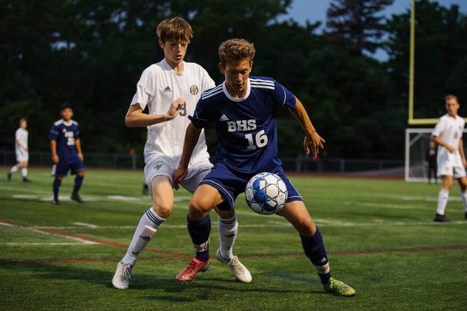 Burlington's Jake Manley (16) battles for the ball with Essex's Kevin Lyon (9) during the high school boys soccer game between the Essex Hornets and the Burlington Seahorses at Buck Hard Field on Tuesday night September 10, 2019 in Burlington, Vermont.