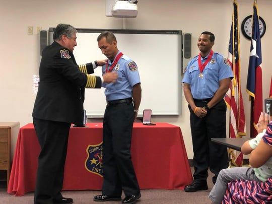 Corpus Christi Fire Department Chief Robert Rocha presents Firefighter II David Torres and Firefighter II Bryan Sayles with Lifesaving Awards on Wednesday, Sept. 11, 2019.