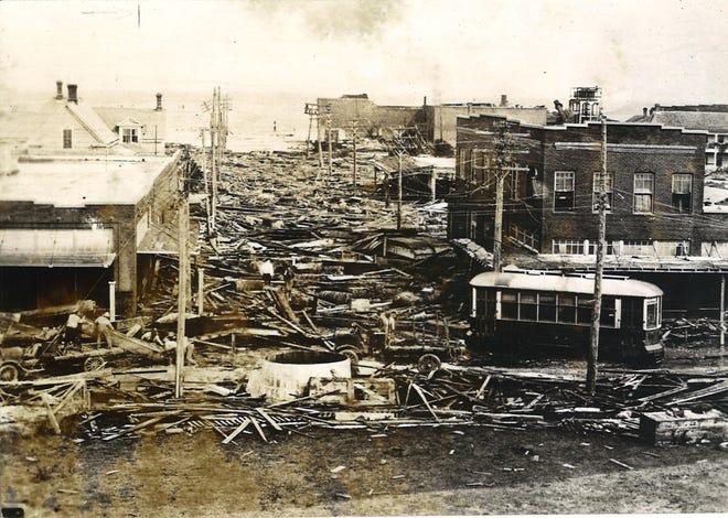 Looking down Laguna Street toward Corpus Christi Bay following the Sept. 14, 1919 hurricane. The streetcar is on Mesquite Street. Laguna Street is now John Sartain Street.