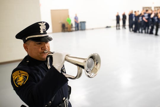 Taps is played by a member of the Corpus Christi police honor guard during the 9/11 Remembrance Ceremony held in the FEMA Dome at Del Mar College on Wednesday, Sept. 11, 2019.