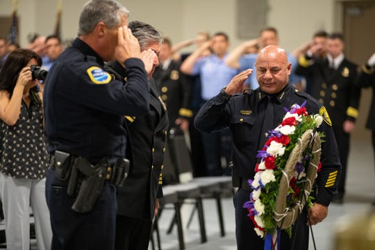 From right Corpus Christi Police Mike Markle, Corpus Christi Fire Department Chief Robert Rocha, and Port of Corpus Christi Police Chief Eric Giannamore salute a wreath during a 9/11 Remembrance Ceremony held in the FEMA Dome at Del Mar College on Wednesday, Sept. 11, 2019.